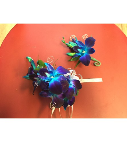blue set of corsage and boutonniere