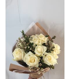 12 White Roses Wrapped