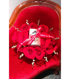 12 red roses in a heart shaped box with Gosanko truffles