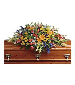 A Colorful Reflections Casket Spray