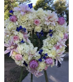 A Sympathy Wreath in Hydrangeas/Roses