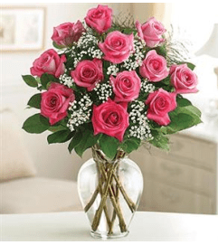 1 DOZEN PINK ROSES IN VASE WITH GREENS AND FILLER