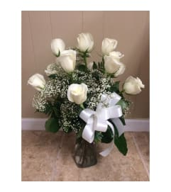 1 DOZEN WHITE ROSES IN VASE WITH GREENS AND FILLER
