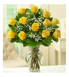 1 DOZEN YELLOW ROSES IN VASE WITH GREENS AND FILLER