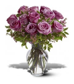 1 DOZEN PURPLE ROSES IN VASE WITH GREENS AND FILLER
