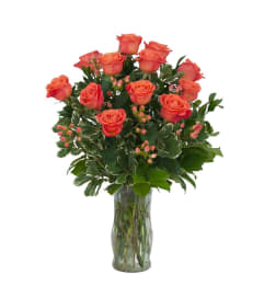 1 DOZEN ORANGE ROSES IN VASE WITH GREENS AND FILLER