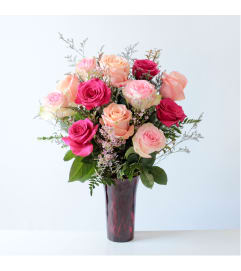 1 Dozen Assorted Pink Roses in a Red Vase