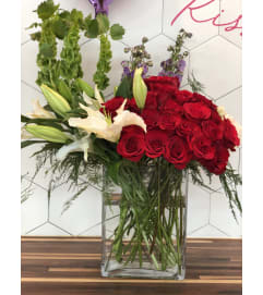 Elevated Two Dozen Roses Florals