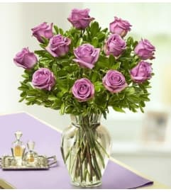 Purple Roses in Clear Vase