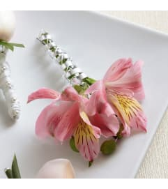 The FTD® Pink Peruvian Lily Boutonniere