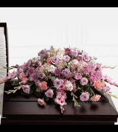 Pastel peace casket spray