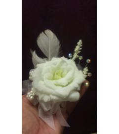 white roses feather