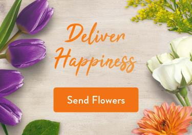 Purple tulips, orange roses, and colorful flowers on a table - flower delivery in Pomfret Center