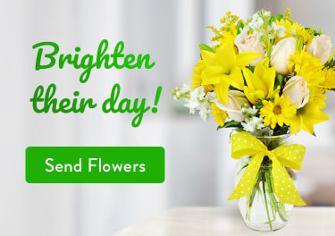 Flower arrangement of yellow lilies and daisies on a table - flower delivery in New Westminster