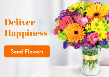 Colorful multicolor arrangement with daisies and roses in a vase - flower delivery in Burlington