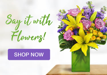 Lavender roses, yellow lilies, and stock in a spring flower arrangement - flower delivery in Niagara Falls