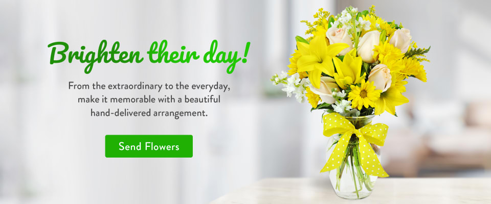Flower arrangement of yellow lilies and daisies on a table - flower delivery in Brantford