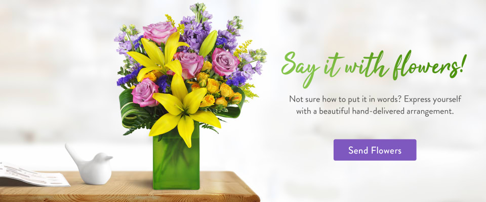 Lavender roses, yellow lilies, and stock in a spring flower arrangement - flower delivery in Vista
