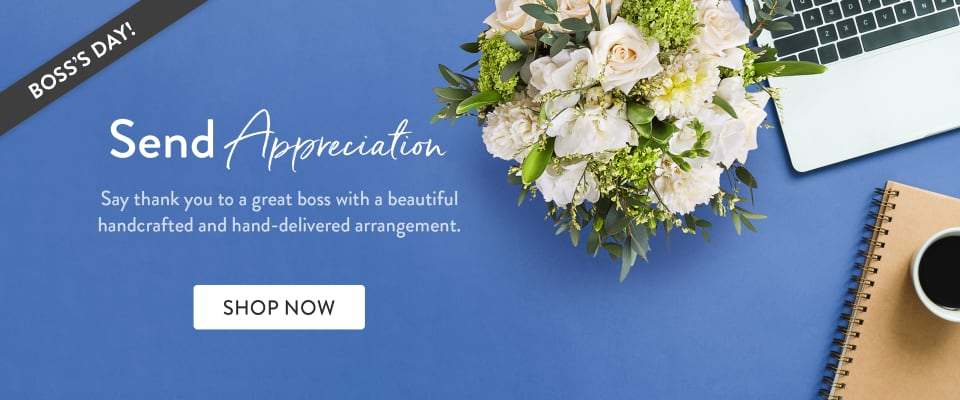 Flowers and office supplies on a desk to celebrate Boss's Day - flower delivery in Toronto