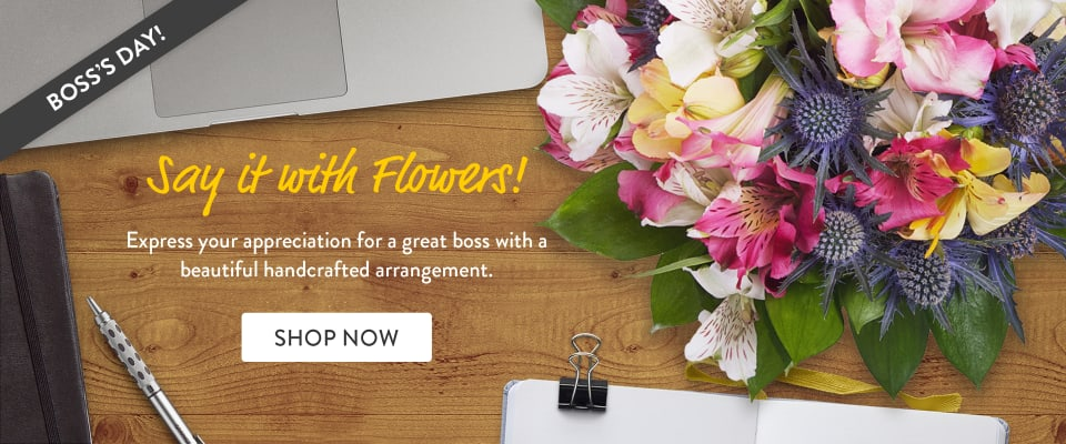Flowers and office supplies on a desk to celebrate Boss's Day - flower delivery in Brentwood
