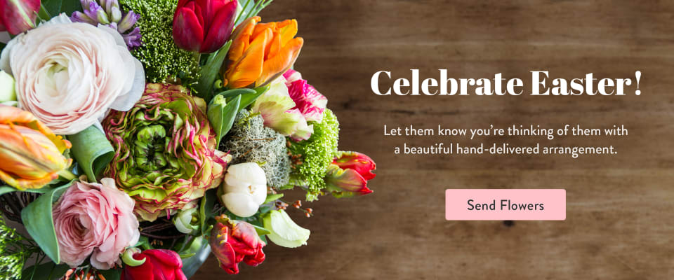 Multicolor Easter flower bouquet on a dark wood background - flower delivery in Easton