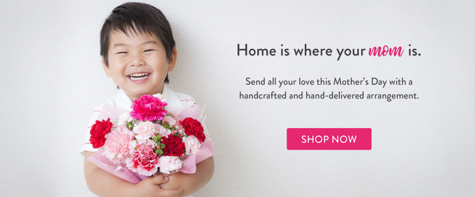 Boy holding pink flowers for Mother's Day gift - flower delivery in Lake Wales