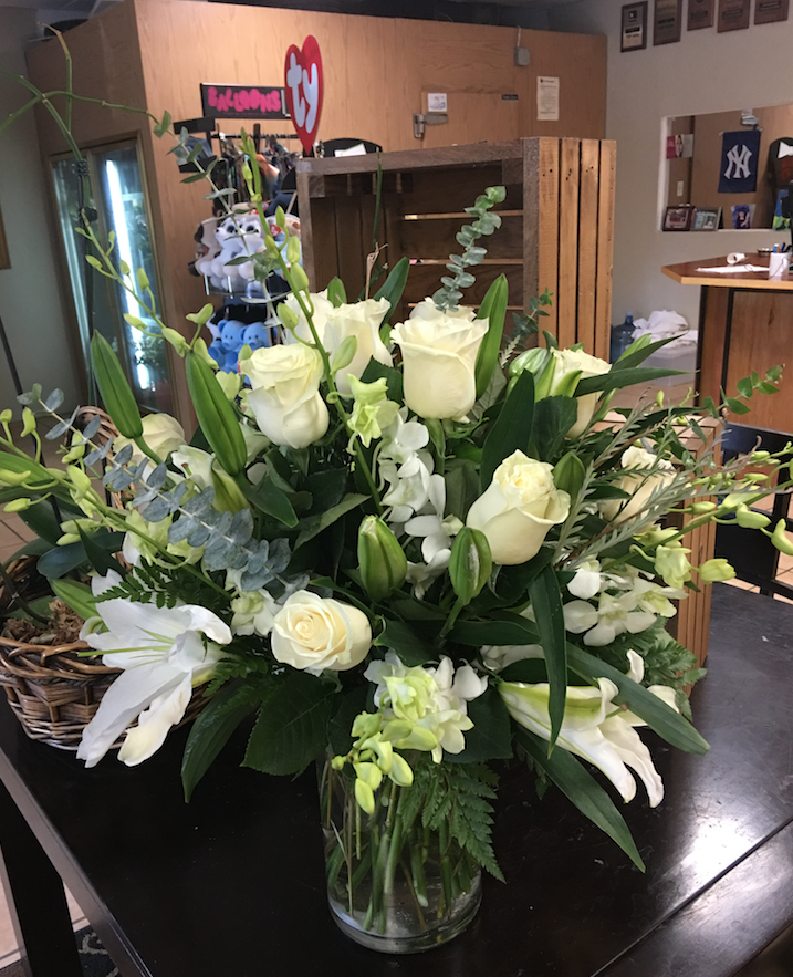 White arrangement with roses