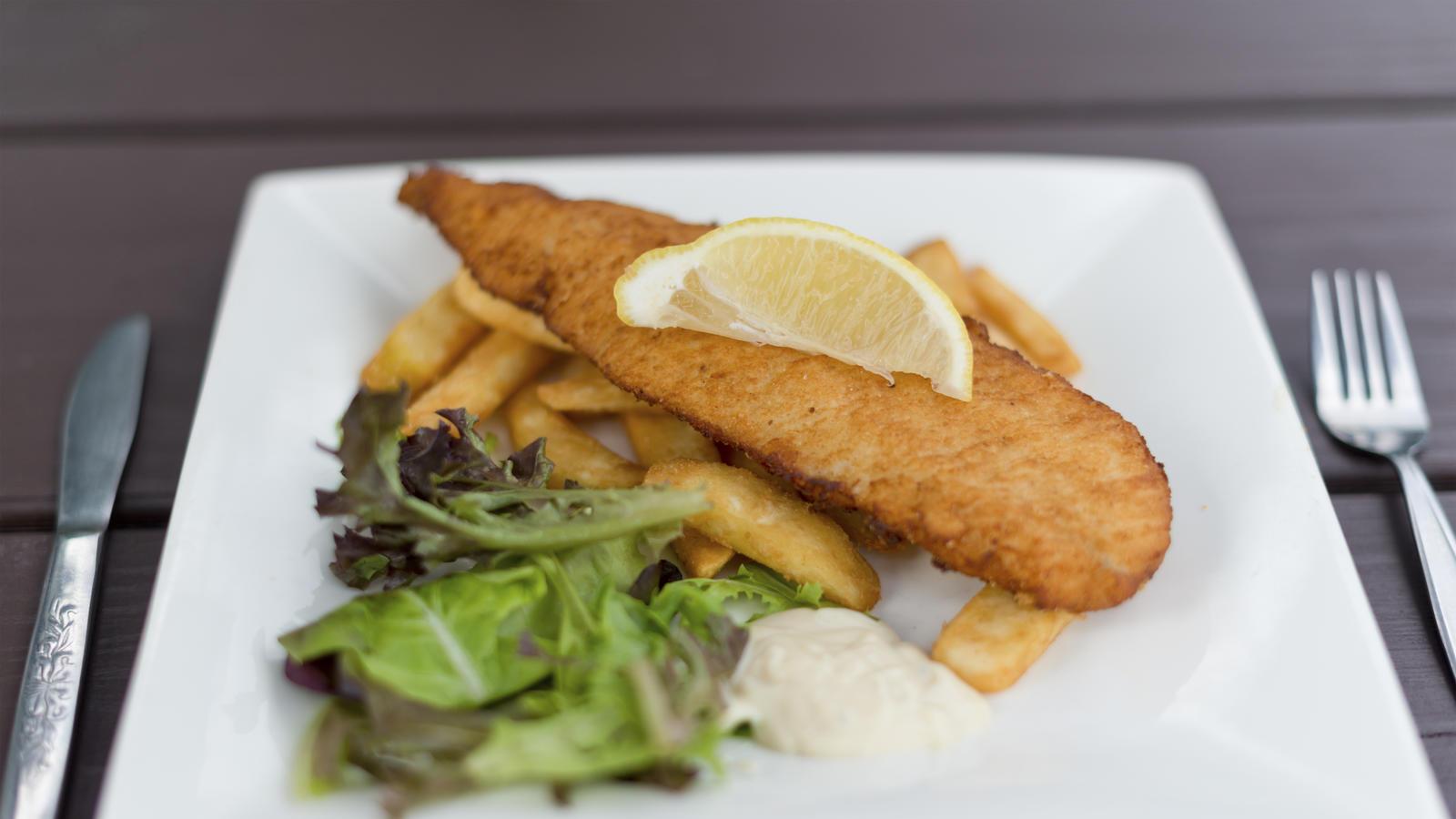 Polenta-crusted hake with pea custard | Good Food Channel