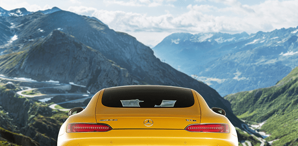 Yellow sports car with mountain background
