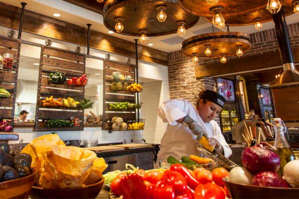 chef in kitchen using fresh ingredients