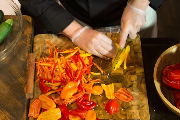 chef in kitchen chopping fresh ingredients
