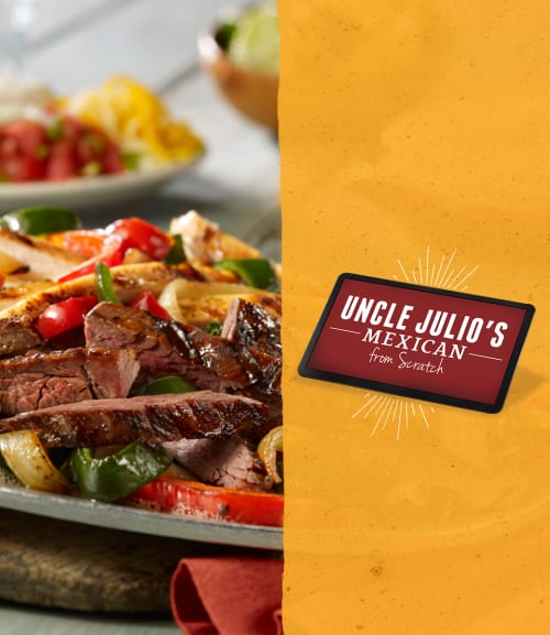 Chicken and steak fajitas next to an Uncle Julio's gift card