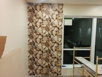 Papier peint imitation Pile de bois de chauffage photo 1