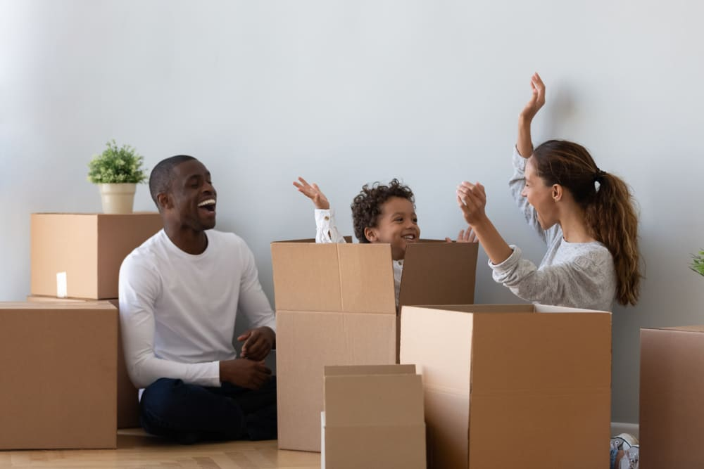 Family packing boxes before a move