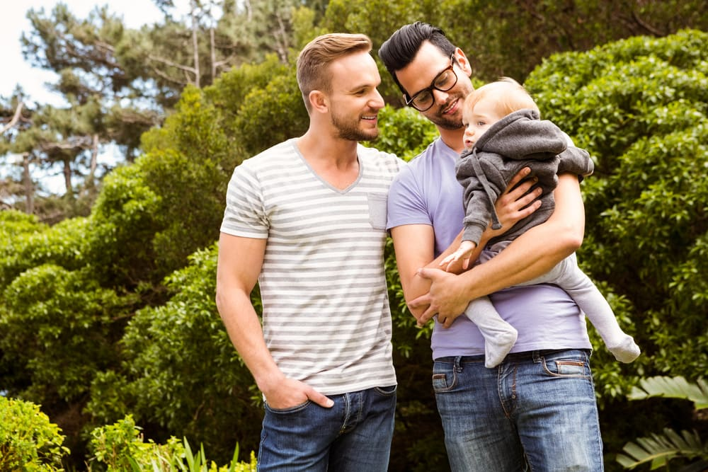 Male couple moving with baby