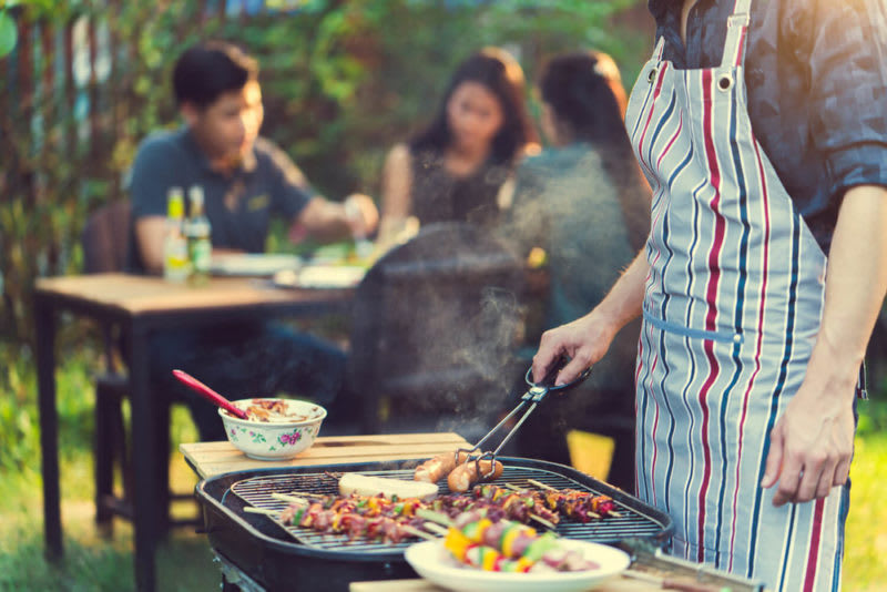 Man barbecuing - townhouse versus condo