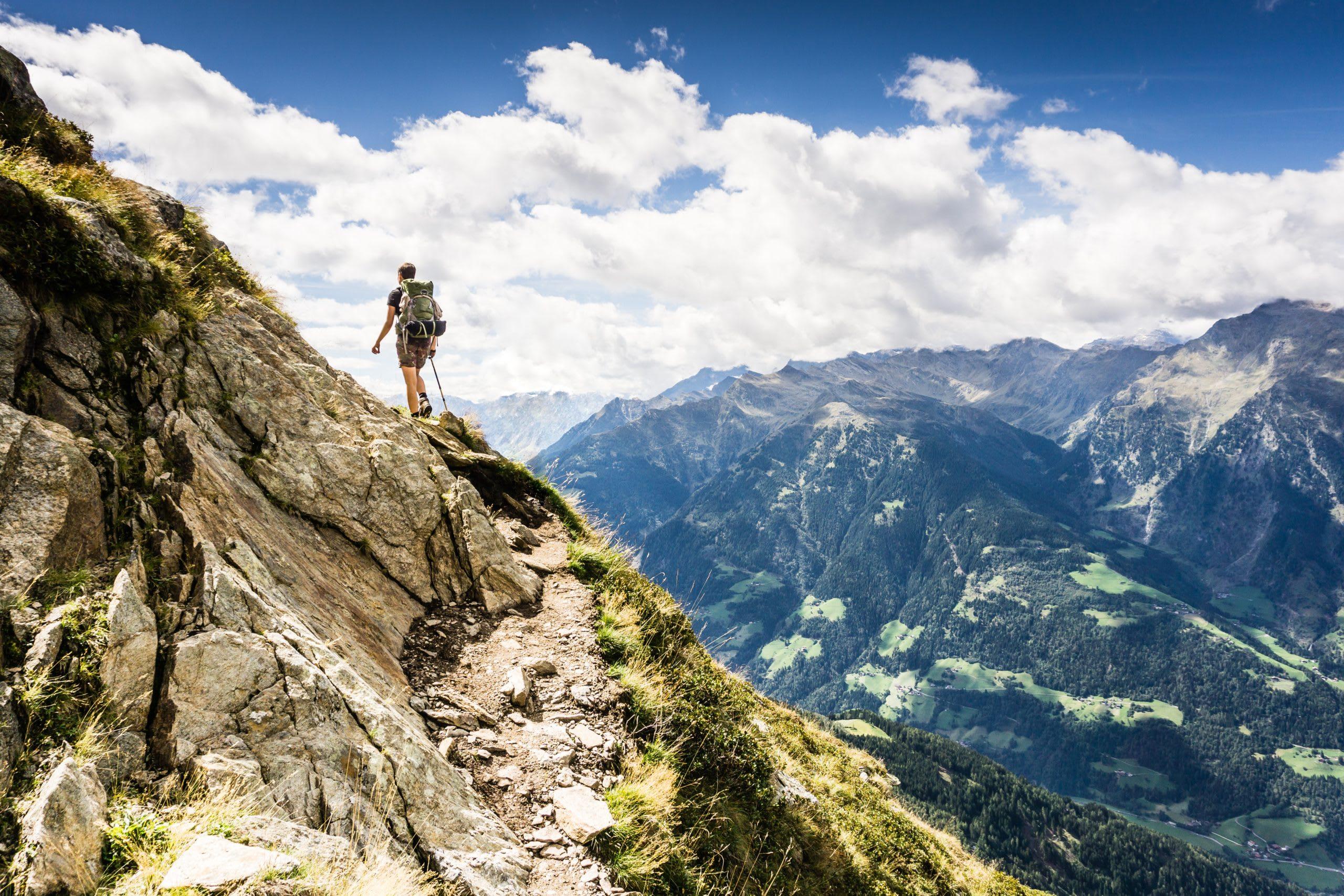 man_hiking_in_a_mountain
