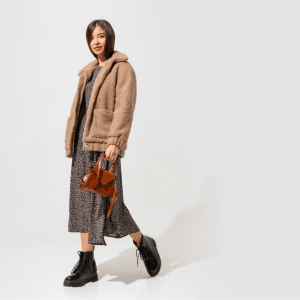 stylish-woman-beige-fur-coat-dress-posing-full-length-min