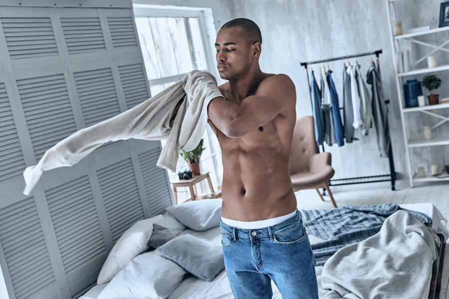 Man getting dressed.