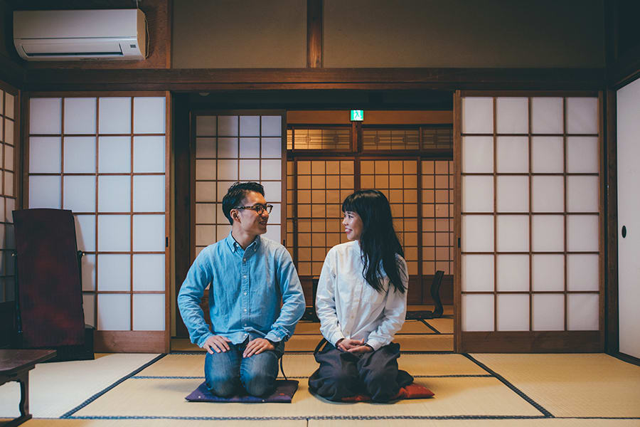 Man and woman sitting on the floor in Japan