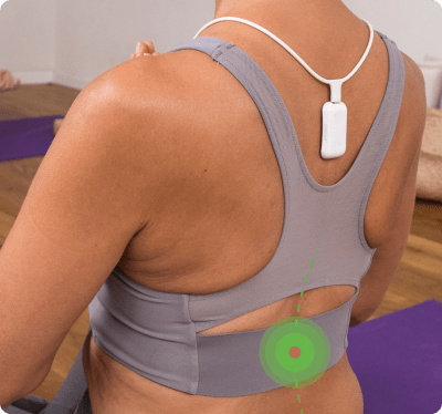 Upright Go necklace correcting woman's lower back posture
