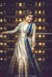 Exquisite Silver Indo-Western Gown With Detailed Golden Print On Borders And Sleek Golden Waist Best Completing Look With Blue Dupatta With Golden Borders by Gautam Khullar Wedding-photography Wedding-dresses | Weddings Photos & Ideas