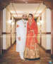 Golden Anarkali With Crimson Red Dupatta Goes Well With the White Sherwani of the Groom by Priyanka Kamboj Wedding-photography Groom-wear-and-accessories Wedding-dresses | Weddings Photos & Ideas