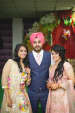 Bride and Groom Pose With a Wedding Guest by Sourav Samanta Wedding-photography Groom-wear-and-accessories Wedding-hairstyles | Weddings Photos & Ideas