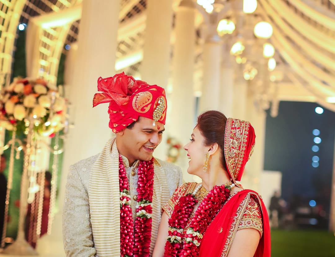 Red And Gold Silk Turban With Gold Kilangi Brooch by Kabeer Grover Wedding-photography Groom-wear-and-accessories | Weddings Photos & Ideas