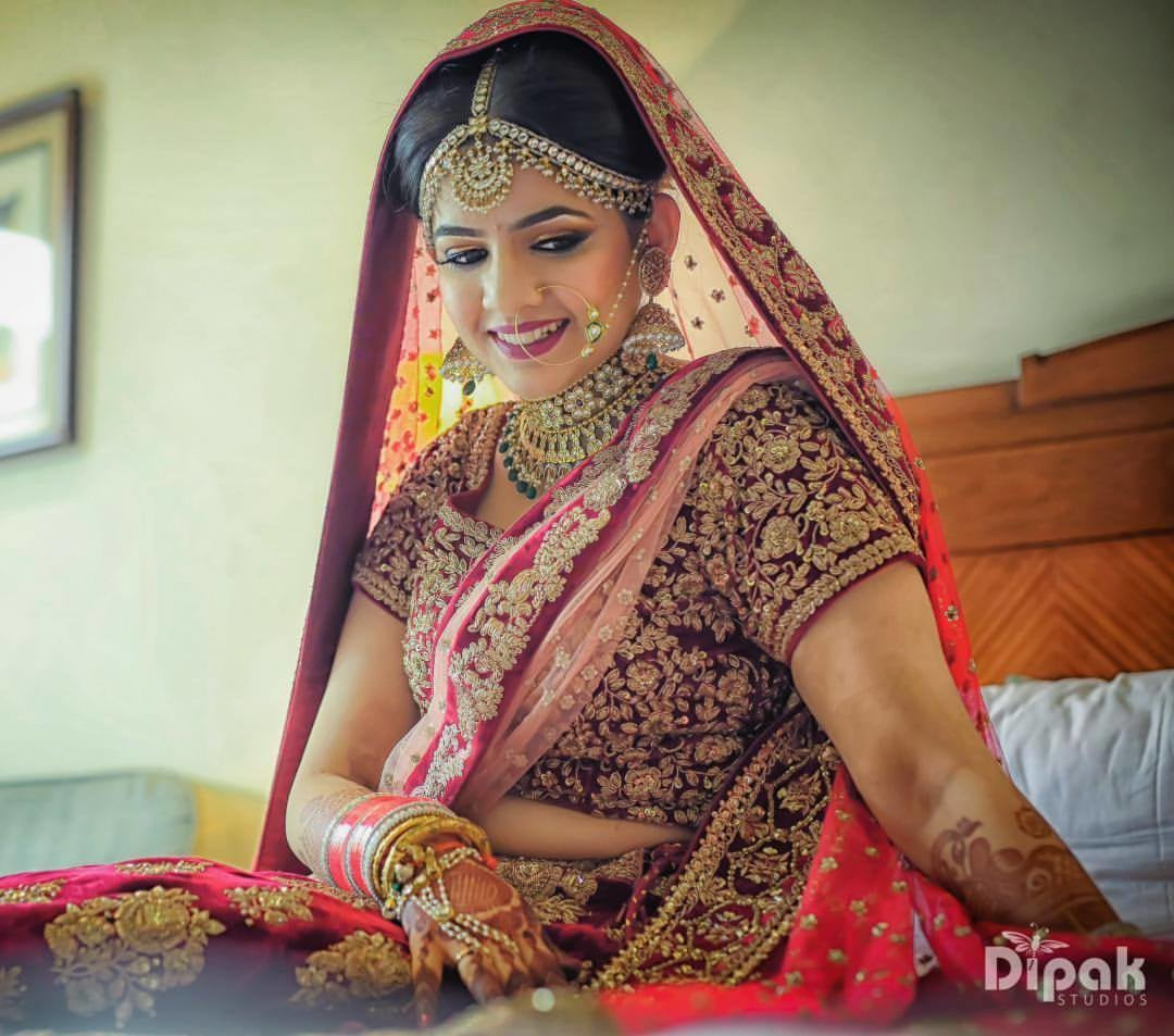 Gold And Gemstone Jewellery With Maroon Lehenga by Kabeer Grover Wedding-photography Bridal-jewellery-and-accessories Bridal-makeup | Weddings Photos & Ideas