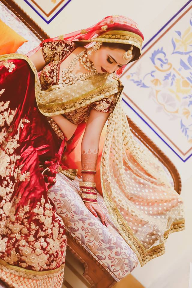 Bride Wearing A Classic Red Lehenga by Arjun Mahajan Bridal-jewellery-and-accessories Wedding-photography Wedding-dresses Bridal-makeup | Weddings Photos & Ideas