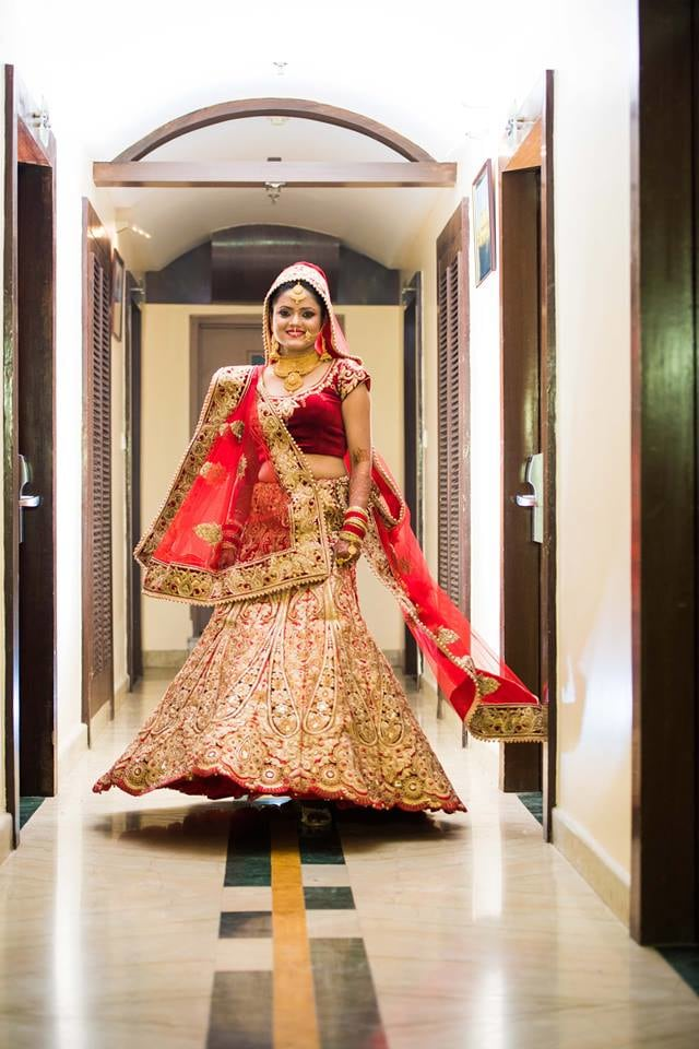 Bride Wearing A Stunning Red Lehenga With Gold Work by Saurabh Wedding-photography Wedding-dresses | Weddings Photos & Ideas