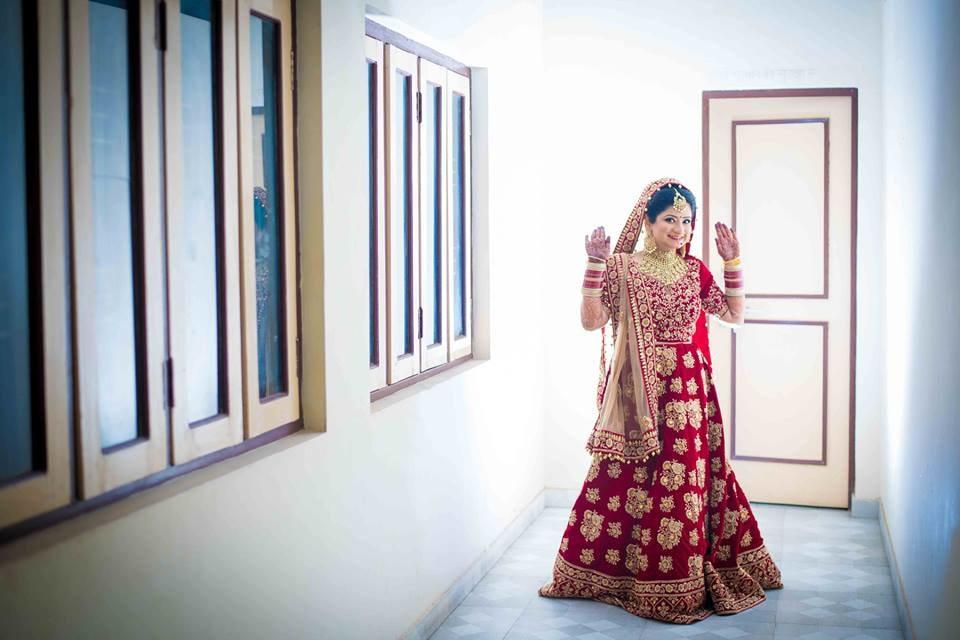 Crimson Shaded Bridal Lehenga With Gold Work by Saurabh Wedding-photography Wedding-dresses | Weddings Photos & Ideas