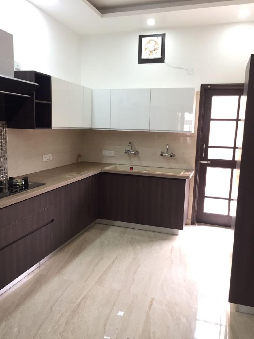 L-shaped modular kitchen design with wooden finish cabinets by Interior Design Modular-kitchen | Interior Design Photos & Ideas